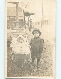Pre-1918 rppc ADVERTISING SIGNS HANG ON STORE BEHIND CUTE LITTLE GIRL ho3802