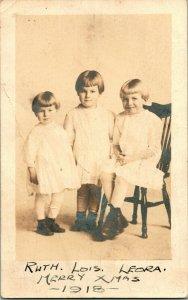 Vtg 1918 RPPC Named Subjects Ruth Lois & Leora Murray Merry Christmas Cute Kids