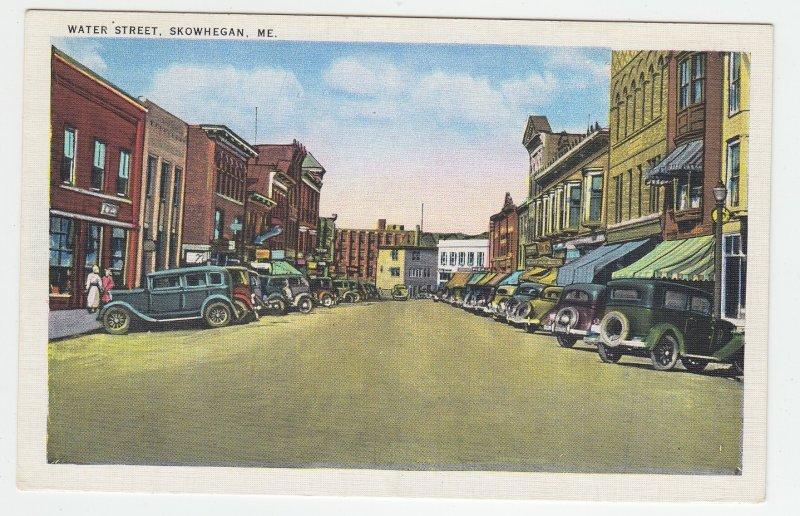 P2033 vintage postcard many old cars stores water street skowegan maine unused
