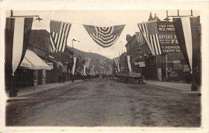 F40/ Salida Colorado RPPC Postcard c1910 Patriotic Stores Wagon