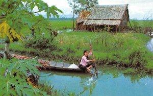 VIET-NAM Scene in rural Viet-Nam Girl In Canoe c1960s Vintage Postcard