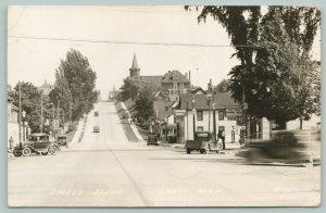 Lanse MI HC Sinclair & Standard Gas Stations~Exchange Hotel, Church~RPPC 1939