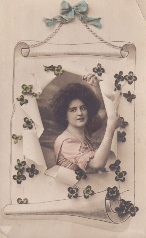 RP: ST. PATRICK'S DAY, 1900-10s; Woman breaking out of roll to put up Four-le...