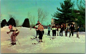 1950s ELLENVIILE, New York Postcard THE NEVELE COUNTRY CLUB Skiing Scene Skiers