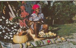 JAMAICA , 1950-60s; Woman selling fruit & animals, Jamaica spelt with fruit