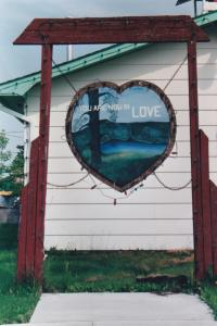 LOVE, Saskatchewan, Canada, 50-70s; Heart shaped wood sign