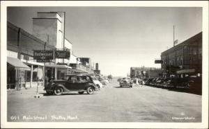 Shelby MT Main St. Old Cars Budweiser Sign Real Photo Postcard