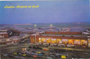 London Airport at dusk , showing Queen's and No.1 Buildings , England , PU-1970