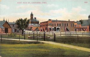 Cherokee Iowa~West Main Street~Railroad Crossing~Fenced in Fountain~c1910 Pc