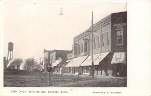 Osceola Iowa~North Side Square~Man in Torn Up Street~Dirt Piles~Water Tower~1905
