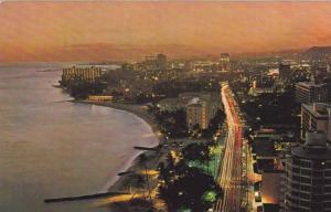 Evening View of Kalakaua Avenue in Waikiki, Hawaii, 40-60s