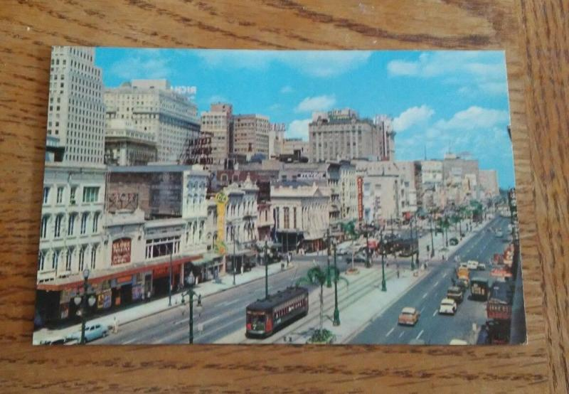 Postcard La Famous Canal Street New Orleans old cars 50's two Trolley lanes