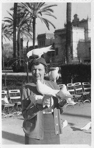 Pigeons on a woman's head Pidgeons 1956