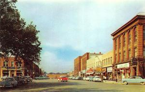 Owatonna MN Street View Storefronts Old Cars Postcard