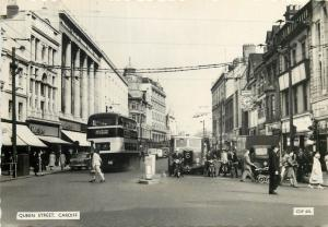 Queen Street Cardiff automobiles bus truck stores Real Photograph Postcard