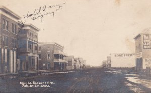 RP: BASSANO, Alberta, Canada, PU-1912; Main Street (Dirt), Hotel, Bond & Berry