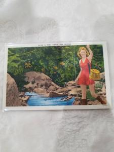 Fine Catch for Anyone  Pretty girl in red dress with Fish