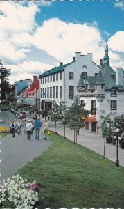 Picturesque Scene, Flowers and Shops at Place d'Armes, Montreal, Quebec, Cana...