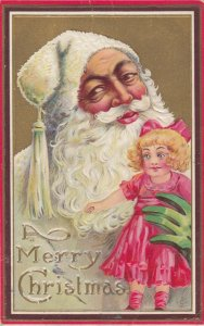 CHRISTMAS, 1908 ; White Suit Santa Claus holds a doll