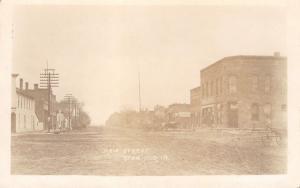 Stanwood Iowa~Main Street~Horse Buggies & Wagons at Stores~Dirt Road~1911 RPPC