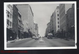 RPPC CARACAS VENEZUELA DOWNTOWN STREET SCENE BUS CARS REAL PHOTO POSTCARD