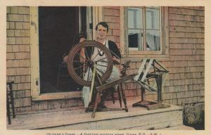GASPE, Quebec, Canada, 1930s; Un rouet a Gaspe, A Habitant spinning wheel