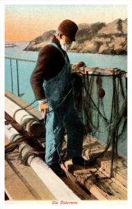 21865  Old fisherman mending nets