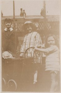 Giant Toy Doll Dolly in Pram Antique Real Photo Postcard