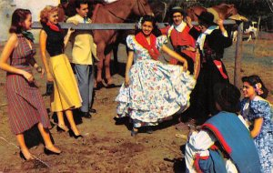 Gauchos and girls perform folk dance in local costume Buenos Aires Argentina ...