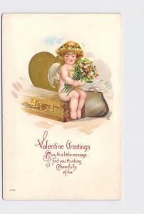 ANTIQUE POSTCARD VALENTINE CUPID SITTING ON SUITCASE WITH ARM FULL OF FLOWERS EM