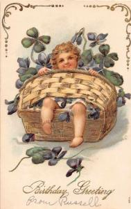 Birthday Greetings Baby in Basket with Clovers Antique Postcard J55141