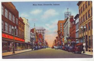 P421 JL linen postcard f.w. wool worth many signs old cars evansville indiana