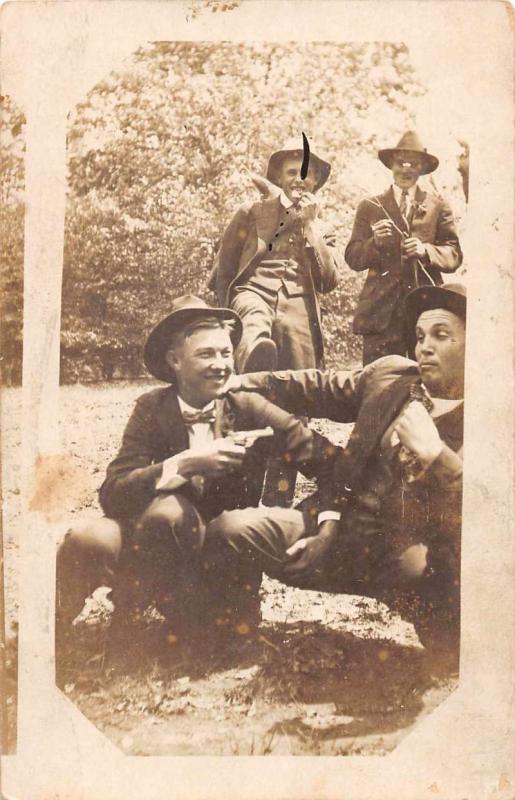 Men in Woods Holding Gun Real Photo Antique Postcard J67660