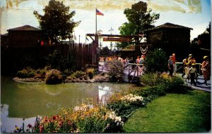 Postcard Disneyland The saga of the West is relived in Frontierland Entrance. O