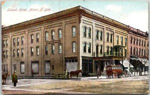 1910s MINOT, North Dakota Postcard LELAND HOTEL Street View / Horse-Drawn Coach