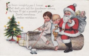 CHRISTMAS, 1920 ; Santa Claus & kids sitting on a Yule Log