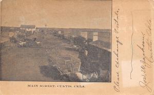 Curtis Oklahoma~Main Street~Windvane in Middle~Storefronts~Jos W Jackson~1907 PC