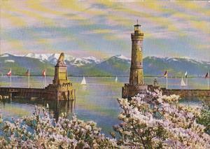 Germany Lindau am Bodensee Magnolienbluete am Hafen Blick vom Hotel Reutemann