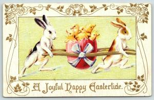 Easter~Racing Upright Rabbits Carry Ducklings in Pink Egg on Long Poles~Embossed