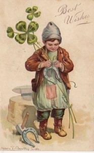 BEST WISHES; 1908; Boy attacing shamrocks to horseshoes, PFB 7614
