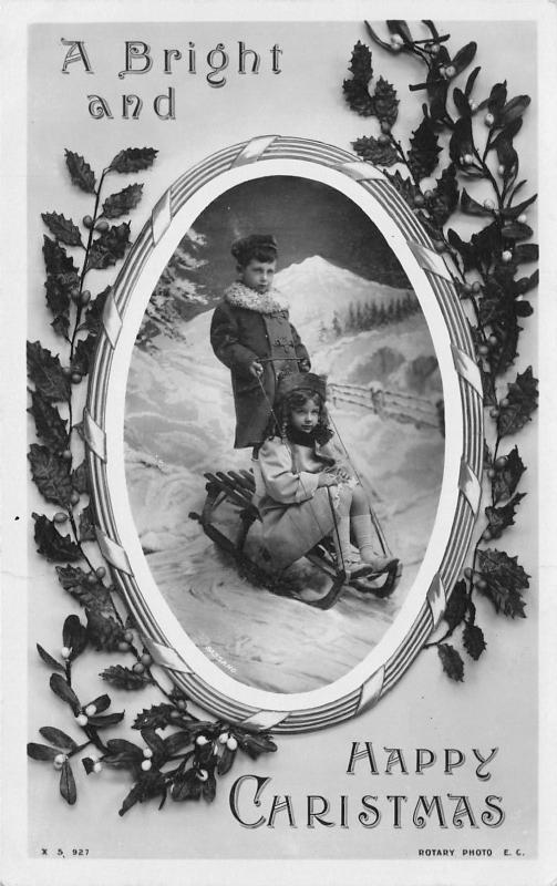 Victorian Christmas~Boy Stands on Lil Girls Sled~Mistletoe Frame~Rotograph RPPC