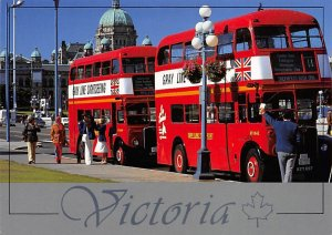 London double-decker buses take visitors on scenic tours through Victoria Bus...