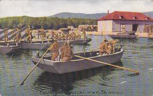 Engineers of the United States Army in row boat building Pontoon Bridge, 00-10s
