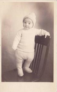 RP, Baby Wearing Winter Clothes & Standing Up On A Chair, 1920-1940s