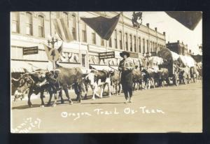 RPPC OREGON TRAIL OX TEAM DOWNTOWN STREET SCENE REAL PHOTO POSTCARD DENNIS