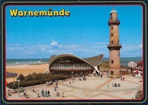 Ostseebad Warnemuende Teepott und Leuchtturm Strand Promenade