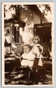 Real Photo Postcard~3 Yr Old Sis Pushes Baby Brother in Stroller~Buggy~1910 RPPC