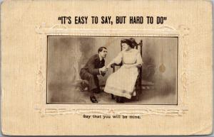 postcard Man on knee proposing to woman in chair - Easy to say, but hard to do