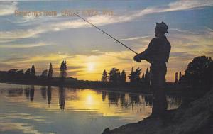 EAGLE RIVER, Wisconsin, 1940-1960´s; Man Fishing at Sunset