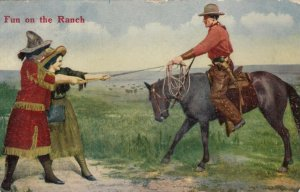 Fun on the Ranch, Cowgirls & Cowboy Horse riding in tug-o-war, PU-1911